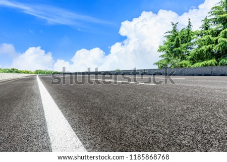 Asphalt highway and green forest natural scenery under the blue sky #1185868768