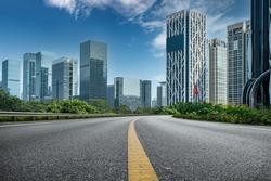 Asphalt highway and urban buildings