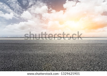 Asphalt highway passing above modern city #1329625901