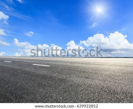 asphalt highway road under the blue sky #639922852