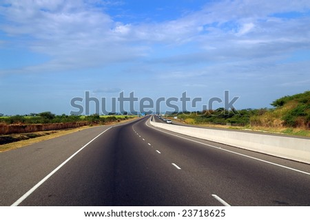 asphalt highway through a rural landscape