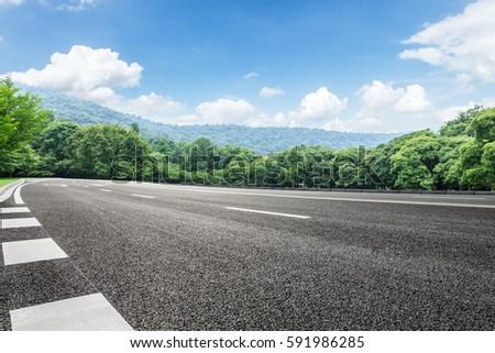 Asphalt highways and mountains under the blue sky