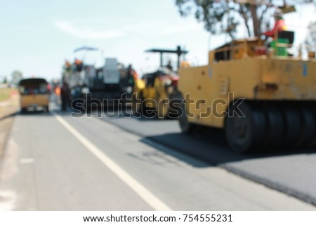 Asphalt Hot – Mix Recycling,Road construction in Thailand As a blur image #754555231