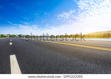 Asphalt road and apartment building with cloud landscape in the city suburbs #1095222305