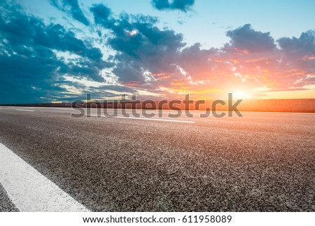 Asphalt road and beautiful sky at sunset #611958089