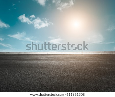 Asphalt road and beautiful sky at sunset