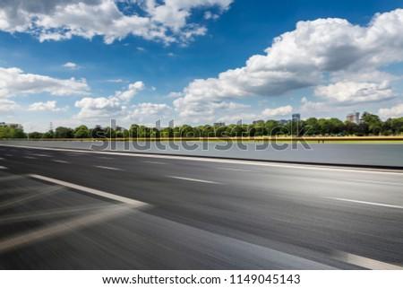 asphalt road and beautiful sky clouds landscape #1149045143