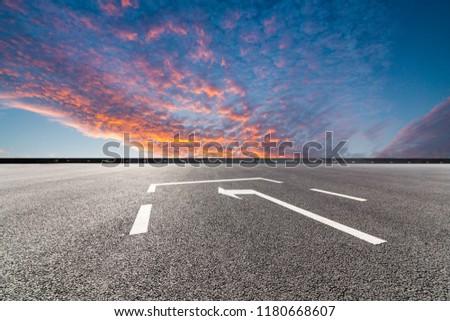 asphalt road and beautiful sky sunset landscape #1180668607