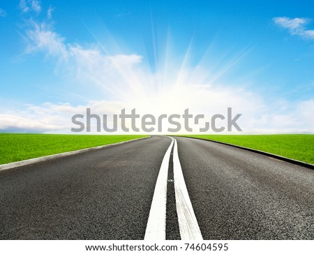Asphalt road and blue sky