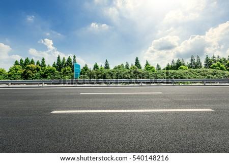 Asphalt road and forest #540148216