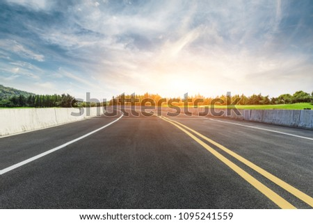 Asphalt road and forest with sky clouds landscape at sunset #1095241559