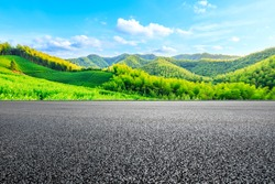Asphalt road and green mountain with bamboo forest natural landscape.