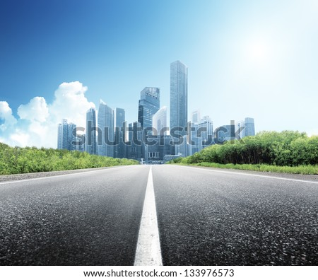 Asphalt road and modern city