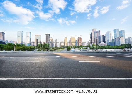 Asphalt road and modern city #413698801