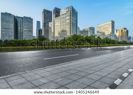 Asphalt road and modern city commercial buildings in Beijing, China Foto stock ©