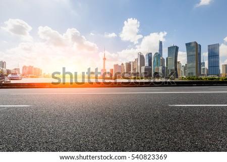 Asphalt road and modern skyline and buildings in Shanghai