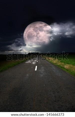 Asphalt road and moon