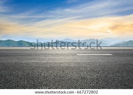 asphalt road and mountain background #667272802