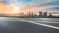 Asphalt road and Qingdao urban construction skyline