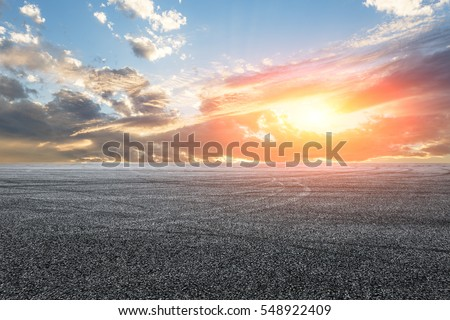 Asphalt road and sky at sunset