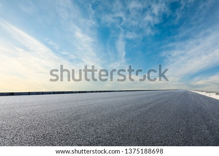Asphalt road and sky cloud background #1375188698