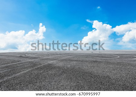 Asphalt road and sky cloud landscape #670995997