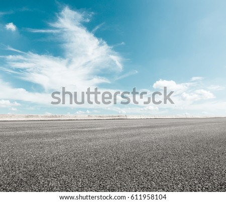 Asphalt road and sky cloud scenery #611958104