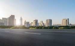 Asphalt road and urban architectural landscape of Ningbo
