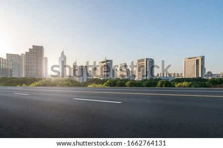 Asphalt road and urban architectural landscape of Ningbo