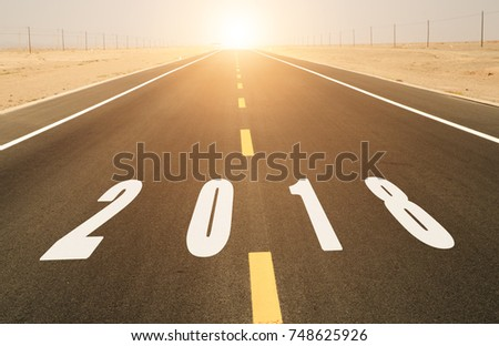asphalt road and 2018 with sunshine ahead