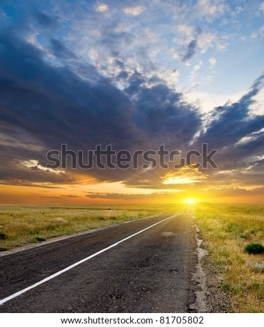 asphalt road at the sunset