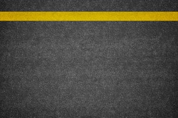 Asphalt road background with yellow line