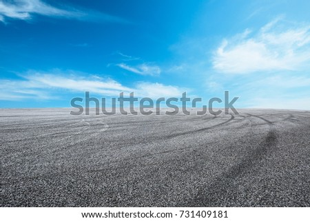 Asphalt road circuit and sky clouds with car tire brake #731409181