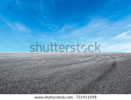 Asphalt road circuit and sky clouds with car tire brake #731411098