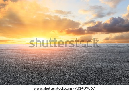 Asphalt road circuit and sky sunset with car tire brake #731409067