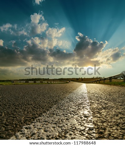asphalt road closeup to sunset