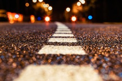 asphalt road leading into the city at night. Selective focus. background