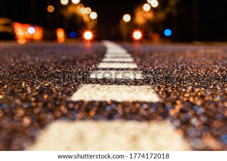 Photo of asphalt road leading into the city at night. Selective focus. background