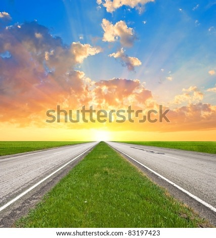 asphalt road leaving far to a sunset