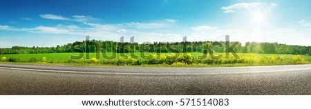 asphalt road panorama in countryside on sunny spring day #571514083