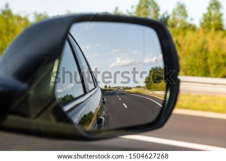 Asphalt road reflected in car mirror. Concept of safe driving. #1504627268