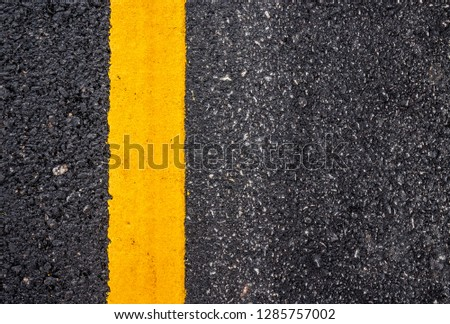 Asphalt road surface with yellow line #1285757002