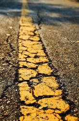 Asphalt road texture with yellow stripe for design