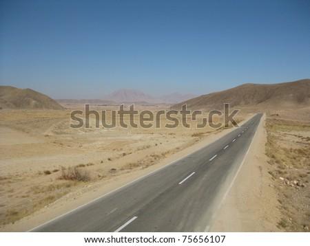 Asphalt road through southern Iran - stock photo