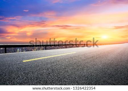 Asphalt road through the modern city above in Shanghai at sunset #1326422354