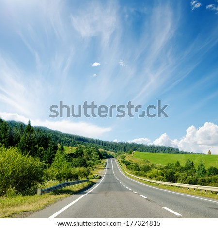 asphalt road to horizon in mountain and blue sky
