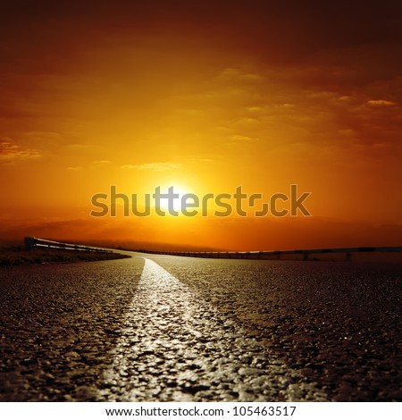 asphalt road to red sunset