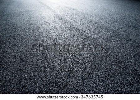 asphalt road under light