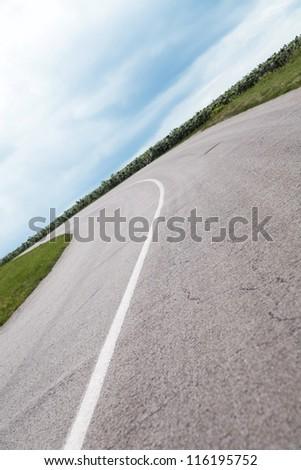Asphalt road with a marking leaving afar