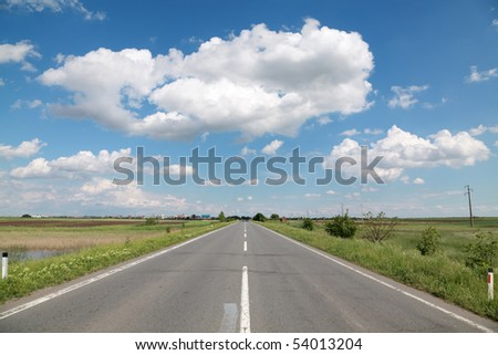 Asphalt road with beautiful sky in spring